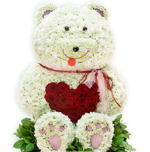 Idei pentru Valentine's Day. Ce cadou îi poți cumpăra persoanei iubite, Urs din flori cu inimă mare, doar 1882,99 RON!